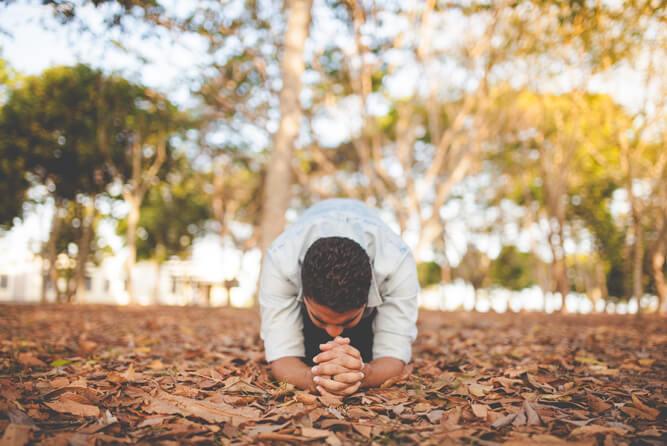 A man on his knees praying