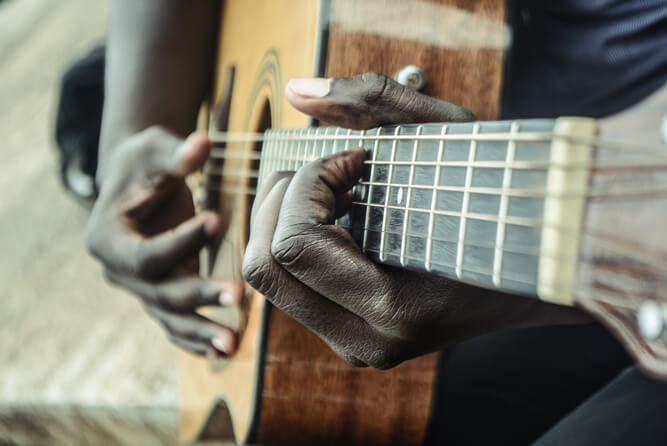 Black male playing the guitar