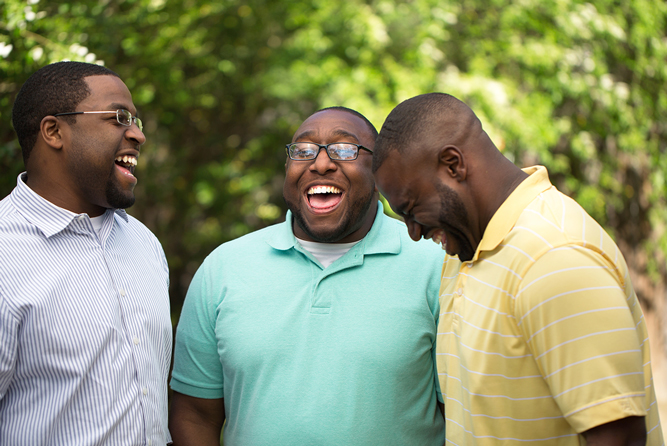 Three African American brothers laughing