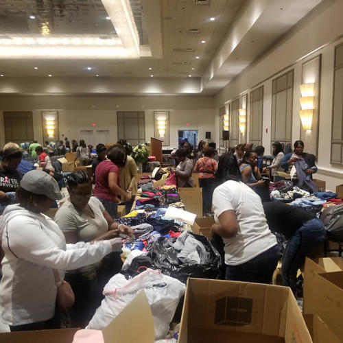 Church members boxing relief items