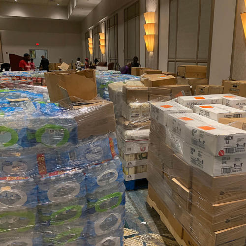 Cases of water and boxes of dry goods on pallets